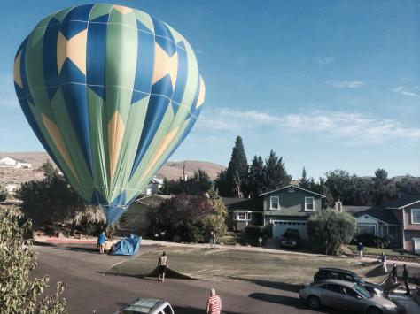 A hot air balloon landed in my front yard this morning.