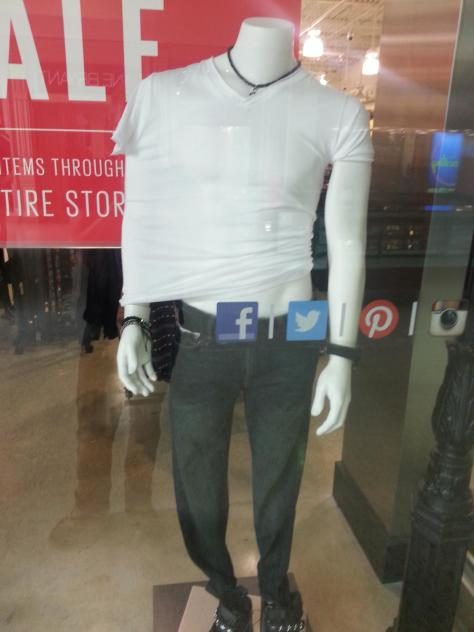 Mall mannequin was inaccurately clothed.